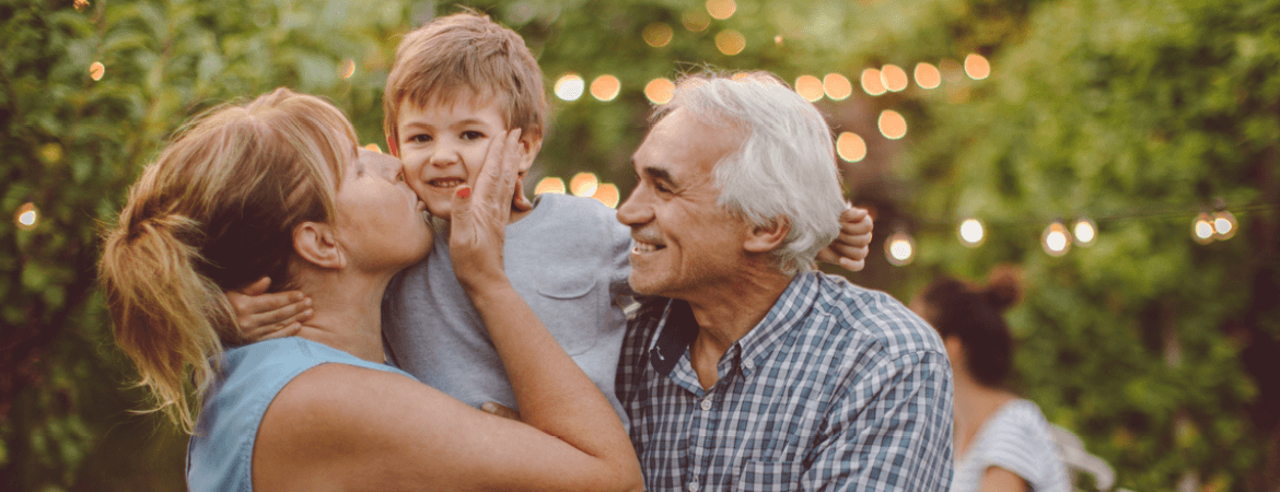 grandparents with grand child at social event