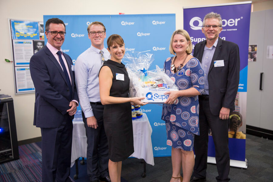Department of Education's Executive Director State Schools - Operations Danielle McAllister hands a gift basket to Glenala State High School Principal Anne Lawson, with QSuper CEO Michael Pennisi, Glenala State High School Success Coach James Brewer and QSuper Trustee and Assistant Secretary Queensland Teachers' Union Jeff Backen