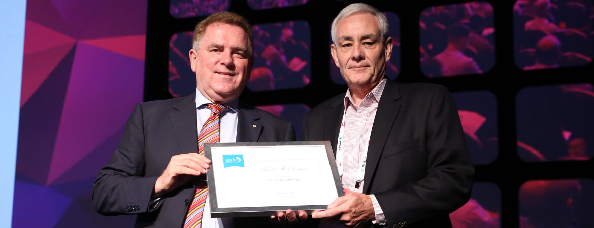ASFA's Independent Chair, Dr Michael Easson AM presents QSuper Chief Investment Officer Brad Holzberger with an award for life membership