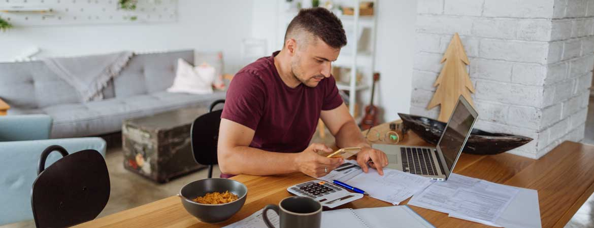 man at home doing finances