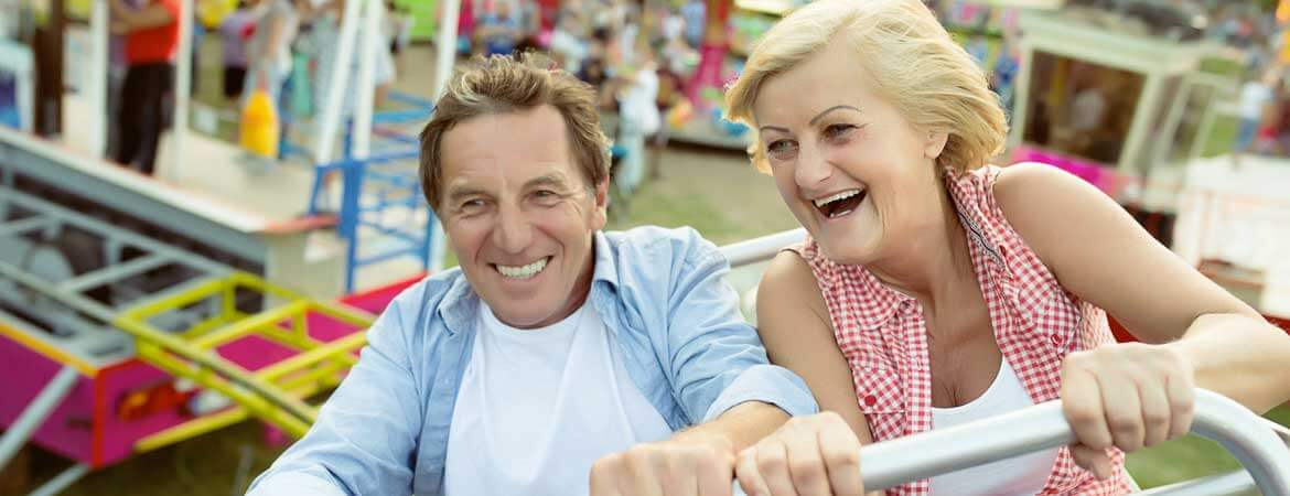 mature couple on a roller coaster